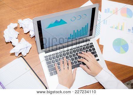 Businesswoman Tired And Stressed With Overworked At Desk, Girl With Worried Not Idea With Graph Anal