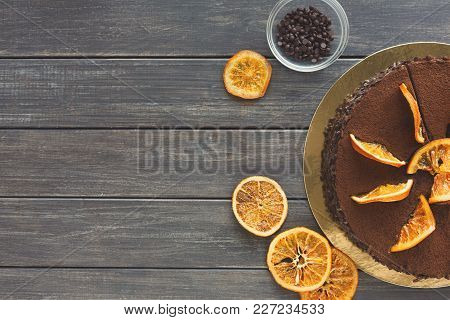 Chocolate Cake With Cream And Profiterole, Decorated With Candied Oranges Top View. Traditional Crea