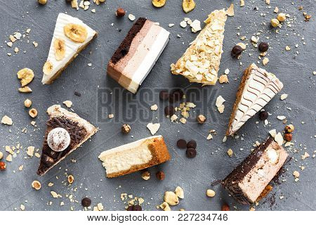 Assortment Of Pieces Of Cake On Messy Table, Copy Space. Several Slices Of Delicious Desserts, Resta