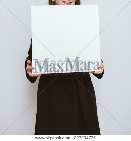 Paris, France - Feb 16, 2018: Smiling Elegant Fashionista Woman Holding Max Mara Italian Cardboard F