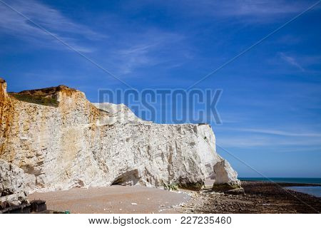 The Seven Sisters white chalk cliffs near Seaford in East Sussex on the south coast of England, Uk
