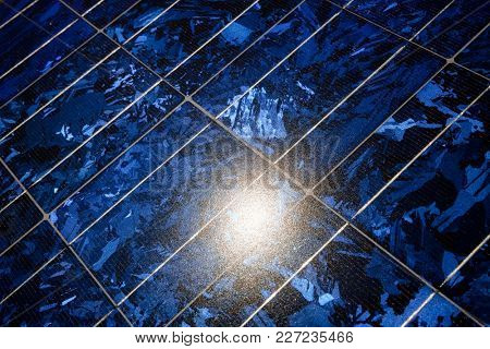 Sun reflecting in roof solar panel system that  absorbs sunlight to generate electricity