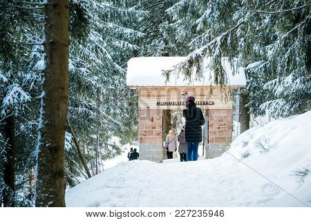 Mummelsee, Germany - Feb 18, 2018: Winter Day With Snow And Tower Gate Mummelseetor Seebach And Woma