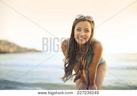 Smiling girl wearing a bikini