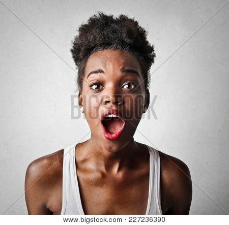 Portrait of shocked woman