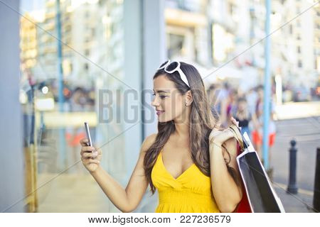 Stylish woman taking a picture