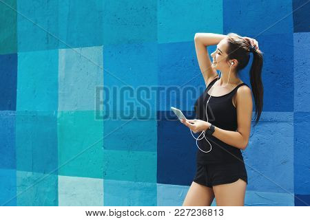 Woman Choose Music To Listen In Her Mobile Phone During Workout In City, Having Rest, Blue Painted W