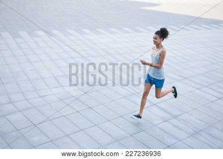 Young African-american Woman Jogging In City, Copy Space