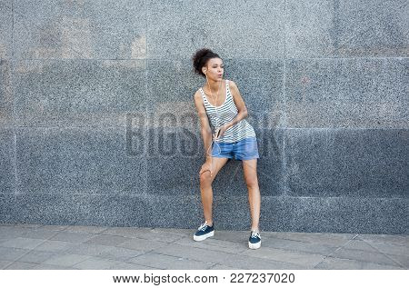 Tired Young Woman Runner Is Having Break, Standing Near Grey Wall, While Jogging In City Center, Cop