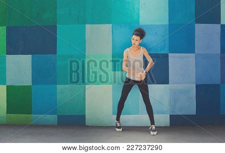 Pensive African-american Woman Posing At Bright Blue Graffiti Wall, Relaxing From Jog Training, Copy