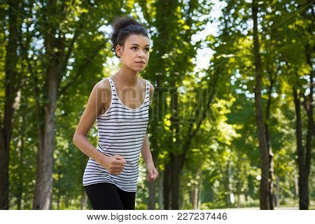 Young Black Sporty Woman Preparing To Run In Green Park During Morning Workout, Copy Space