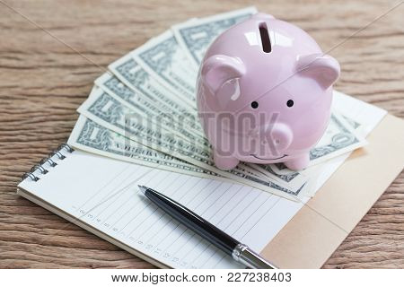 Financial Goals And Check List Priority, Revenue And Expense Or Saving Habit, Pen On Paper Notepad W