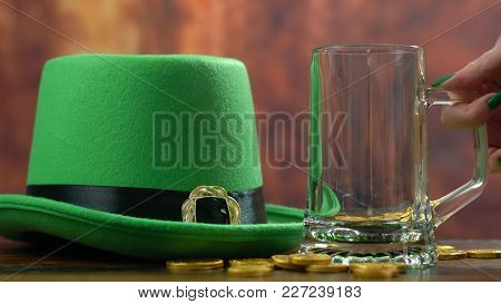 St Patrick's Day Pouring Green Beer With Green Leprechaun Hat