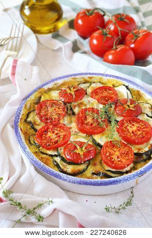 Zucchini And Tomatoes Gratin With Bechamel Sauce And Cheese