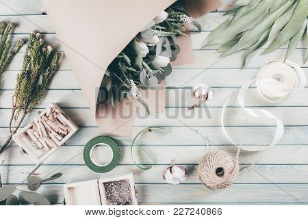 Florist Workplace With Flower On Wooden Background