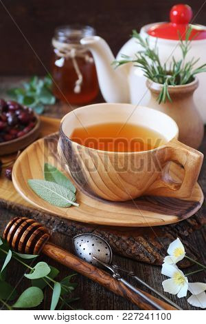 Healthy Herbal Tea With Medicinal Herbs, Dog Rose And Honey. Rustic Style