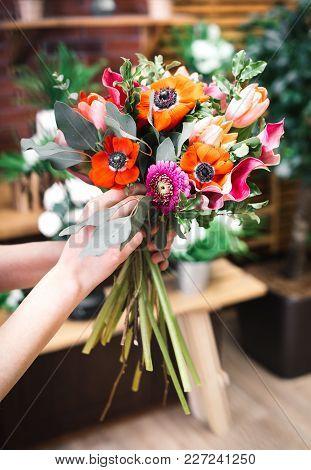 Florist Arrangement A Flowers Bouquet At His Workplace