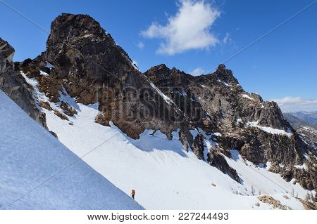 A Climber On The Silver Star Glacier Under Vasiliki And Ares Towers. Washington Pass, North Cascades