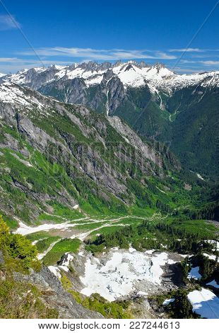 The Rugged Skyline Of The Picket Range And The Remains Of A Melting Glacier Viewed From The Summit O