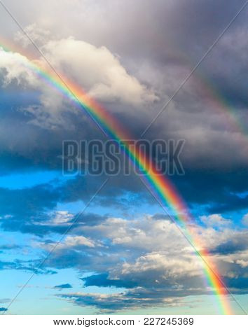 Real Rainbow In The Cloudy Sky Stock Photo