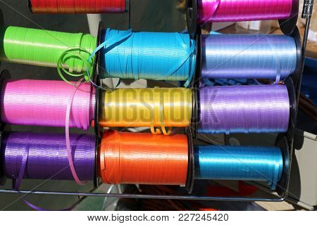 spools of colored ribbon