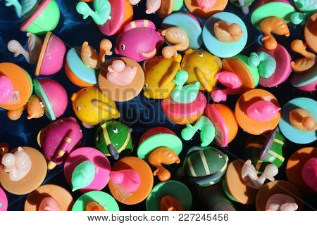 close up of duck toys in a pile in water at a carnival. background image of toys in a pile