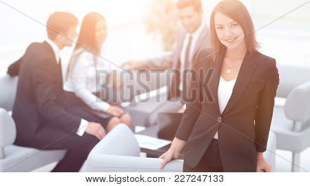 young business woman on blurred background office