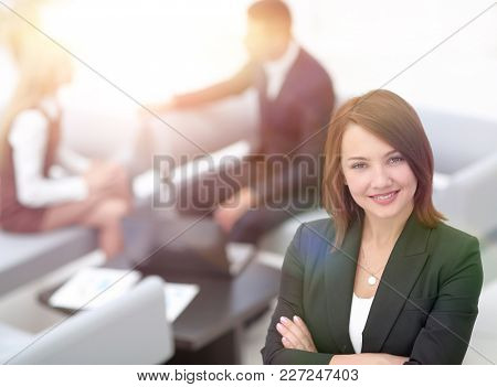 successful young business woman on blurred background office