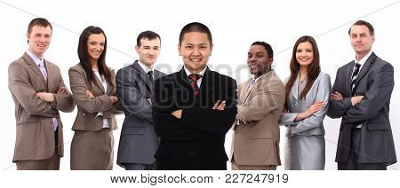 businessman standing in front of his business team