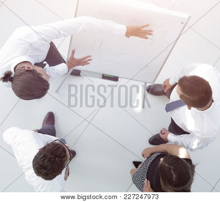 view from the top. background image of a business team discussin