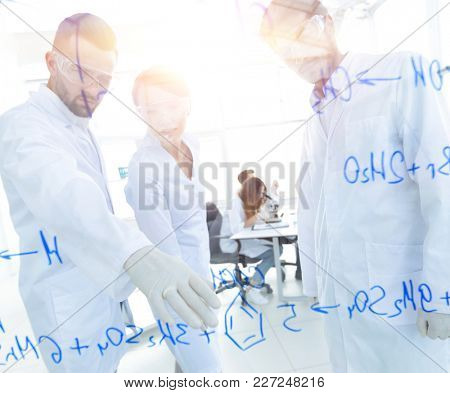 group of young scientists talking in a lab