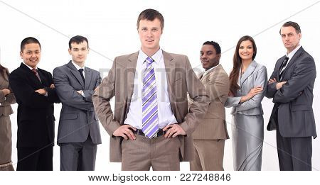 speaker standing in front of his business team