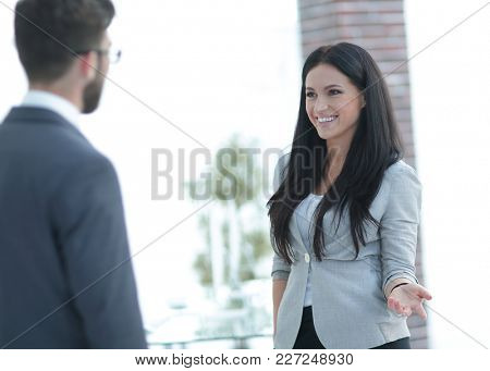 Business woman communicating with colleague in the office