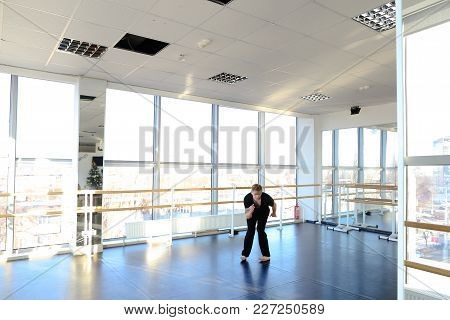 Young Guy Making Hand Stretching At Dancing Studio. Male Person Doing Physical Exercises. Concept Of