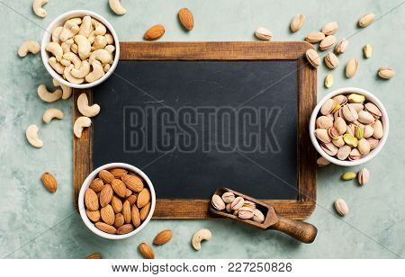 Fresh Organic Nuts, Almonds, Cashew, Pistachio. Healthy Food And Cuisine. Food Background With Copy
