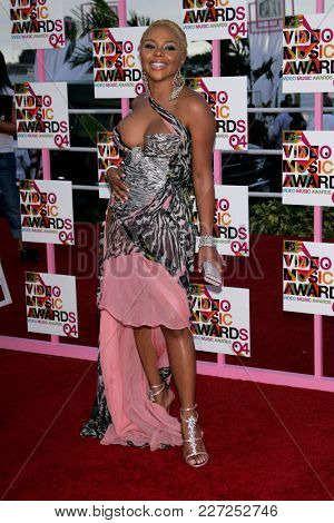 LOS ANGELES - AUG 29:  Lil Kim arrives to the Mtv Video Music Awards  on August 29, 2004 in Miami, FL.