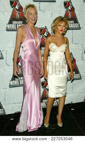 LOS ANGELES - JUN 05:  Sharon Stone and Christina Aguilera arrives to the Mtv Movie Awards  on June 5, 2004 in Culver City, CA.