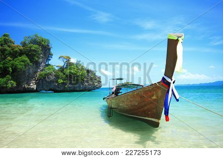 Long Tail Boat By The Shore At Koh Hong Island,  Kra Bi Andaman Sea Of Thailand Against Beautiful Cl