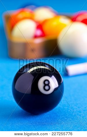 Billiard Pool Game Eight Ball With Cue And Eightball Balls Set Up On Billiard Table With Blue Cloth