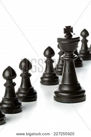 King Chess Figure In Front Of Row Of Pawn Chess Figures - Management, Leadership, Teamlead Or Strate
