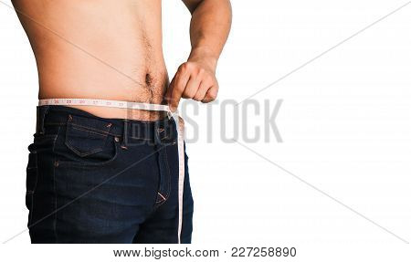Close Up Man In Blue Jeans Try To Loss Weight Isolated On White With Space Use For Texts Display