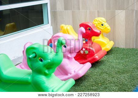 Colorful Plastic Seesaw On The Artificial Grass