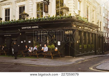 London, England - October 25 2017: Old Fashioned Style London Corner Pub. Warm Sunny Day In The City