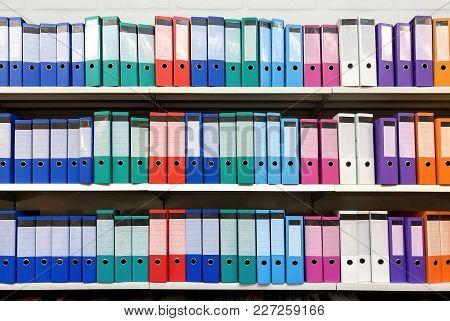 Colorful Ring Binder Folder On White Shelves, Office Stationary