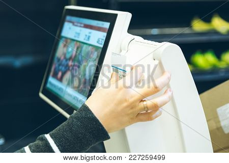 Woman Take Sticker With Price After Weigh Products