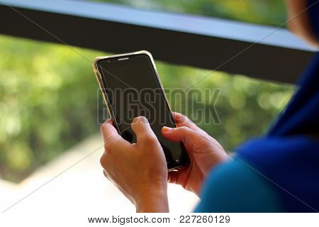 Women Holding And Typing On Smart Phone