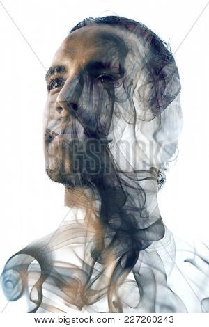 Unique conceptual work bringing together the unpredictable nature of smoke with the firm gaze of a young attractive man with a nose ring