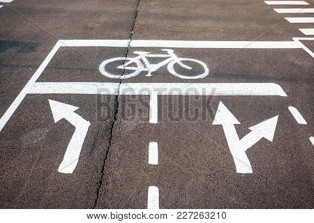 Cycle Path And Direction Indicators On The Ground
