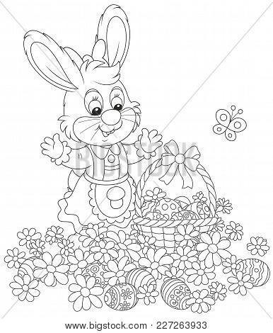 Easter Egg Hunt In Flowers. Little Bunny With A Decorated Basket Collecting Painted Eggs Among Daisi