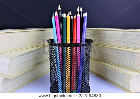 An Concept Image Of Some Colorful Pencils With Some Books